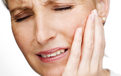 Mature woman with tooth ache